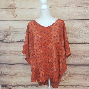 Manuhealii oversized high low blouse